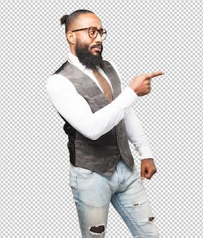 ビジネスの黒人男性の指で指しています。