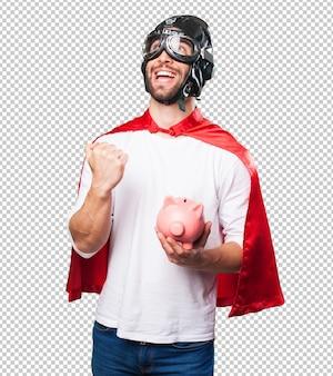 貯金箱を保持しているスーパーヒーロー