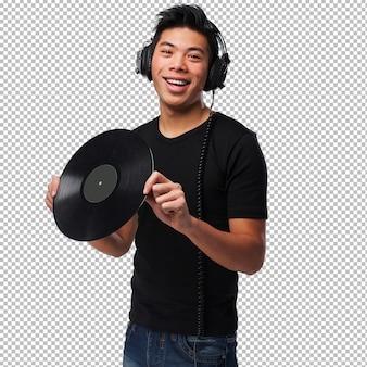 ヘッドフォンとビニールを持つ中国人男性