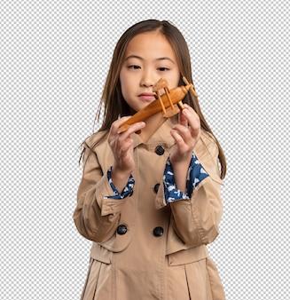 飛行機を保持している中国の少女
