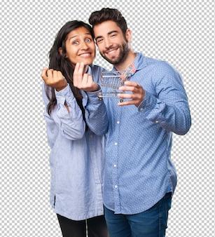 ショッピングカートを保持している若いカップル