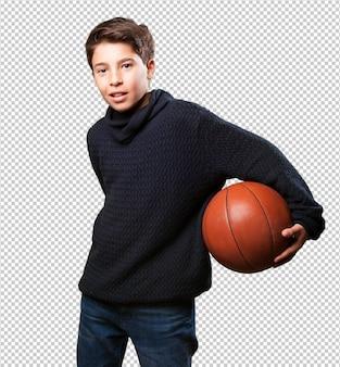バスケットをしている少年
