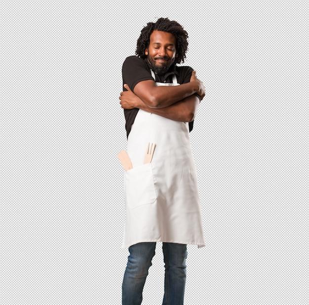 ハンサムなアフリカ系アメリカ人のパン屋誇りと自信を持って、指を指す、従うべき例、満足、,慢と健康の概念