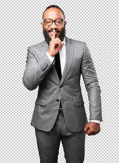 Бизнес черный человек делает жест молчания