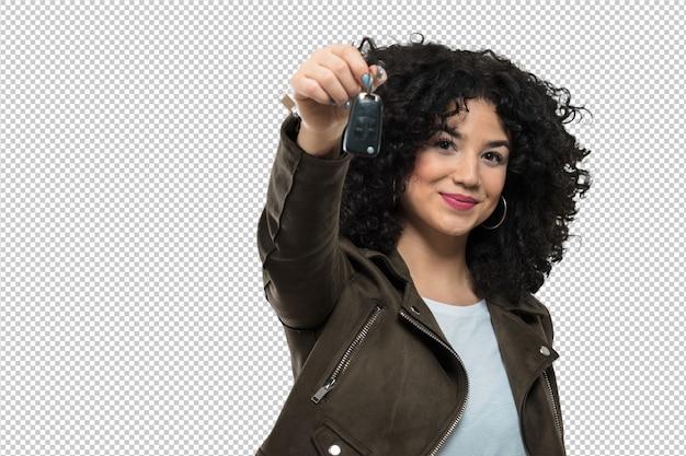 車のキーを保持している若い女性