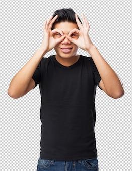Прохладный жест очков китайского человека