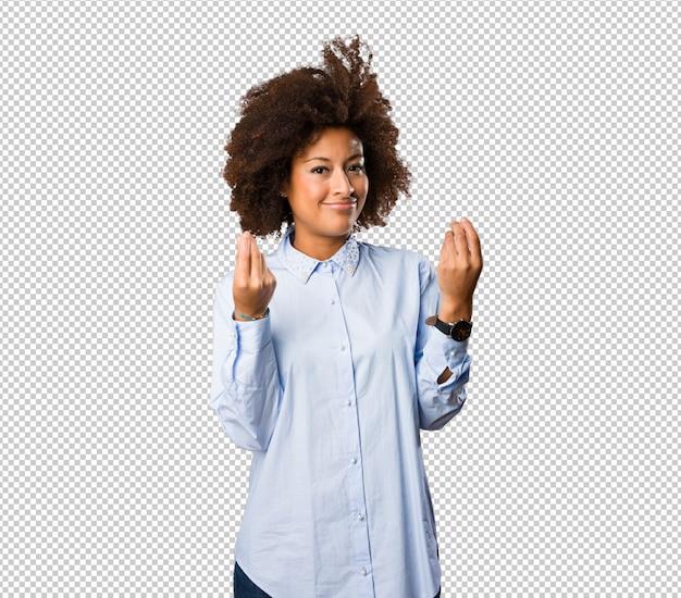 Молодая негритянка делает богатый жест