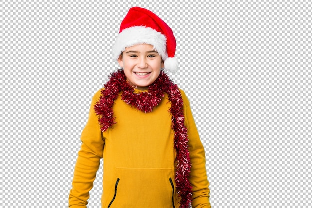 サンタの帽子をかぶってクリスマスの日を祝う少年は、幸せ、笑顔、陽気な分離しました。