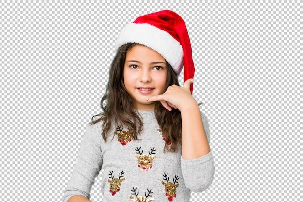 指で携帯電話呼び出しジェスチャーを示すクリスマスの日を祝っている少女。