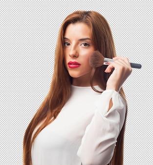 エレガントな女性は、ブラシを持つ