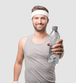 水のボトルを持つスポーティーな男