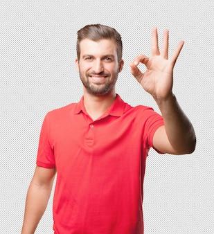 Мужчина в красной рубашке, хорошо действующий жест