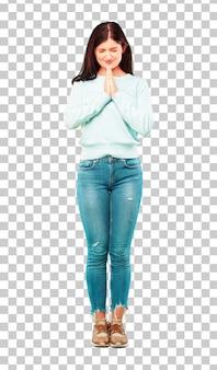 若いかわいい女の子のフルボディは、聖なる方法で祈って、懇願