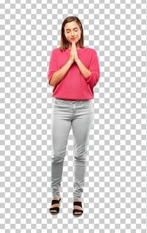若い女性のフルボディ。聖なる方法で祈って、懇願する