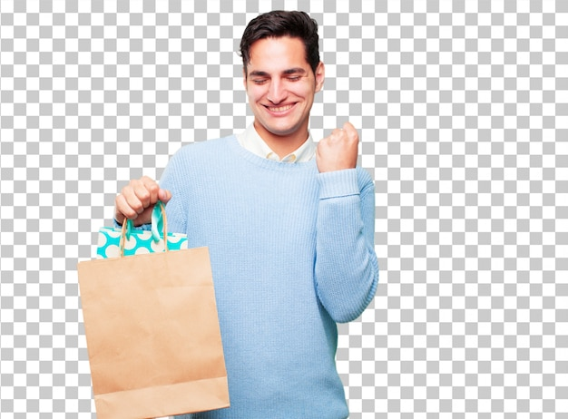 買い物袋を持つ若いハンサムな日焼け男