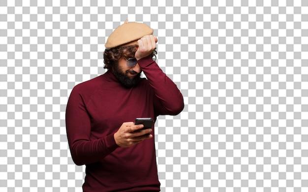 ベレー帽と携帯電話を持つフランス人アーティスト
