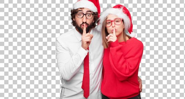 Молодая пара, выражая рождественские концепции. пара и фон в разных слоях