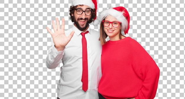 クリスマスの概念を表現する若いカップル。カップルと異なるレイヤーの背景