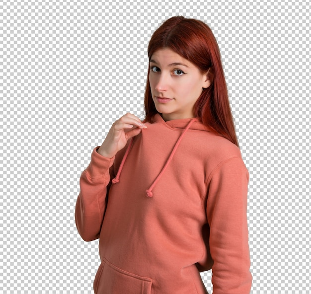 ピンクのスウェットシャツと若い赤毛の女の子は誇りと自己満足の自分のコンセプト