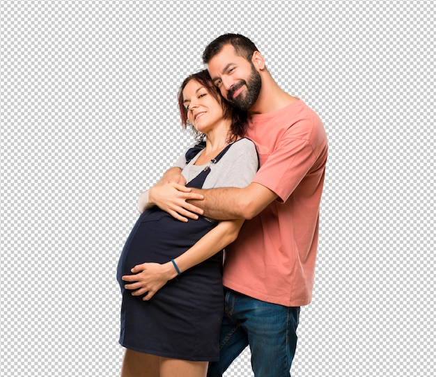 妊娠中の女性と抱き合っているカップル