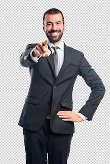 正面を指しているビジネスマン