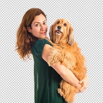 彼女の犬を抱擁する少女
