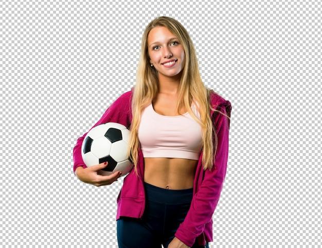 サッカーボールを保持しているかなりスポーツ女性