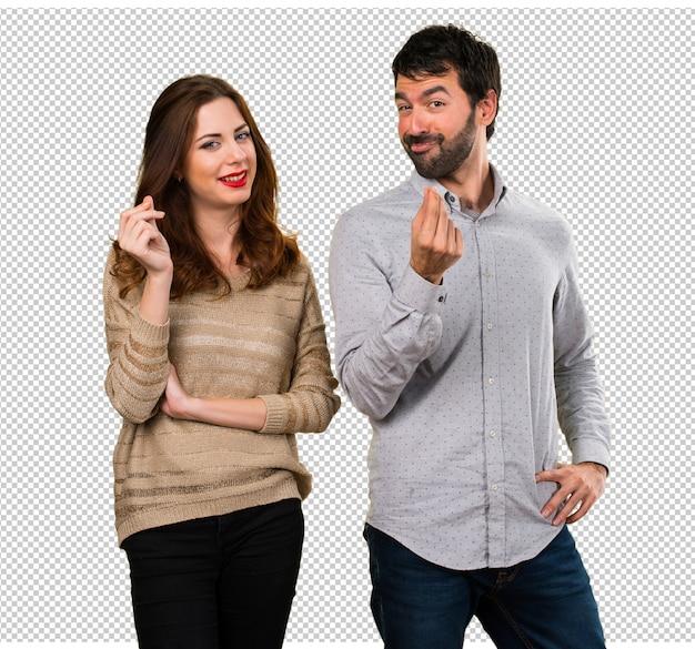 若いカップル作るお金のジェスチャー