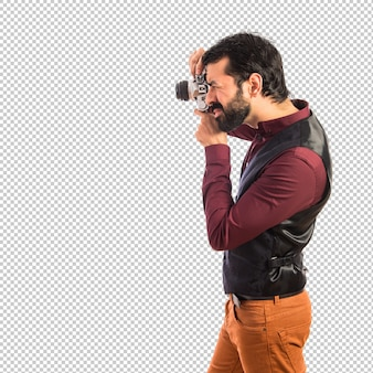 チョッキの写真撮影を着た男