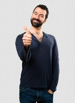 Красивый мужчина с бородой с пальца вверх