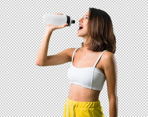 ボトルを持つスポーツ女性