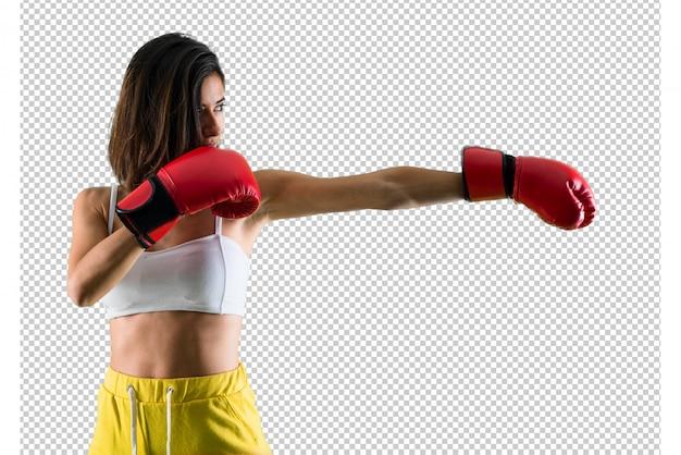 ボクシンググローブを持つスポーツ女性