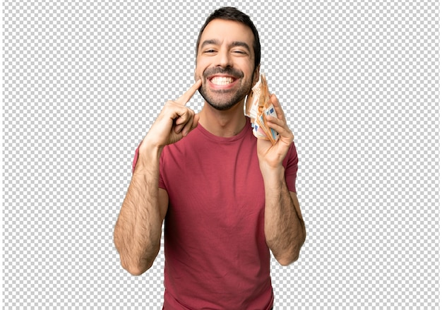 Человек, принимая много денег, улыбаясь со счастливым и приятным выражением