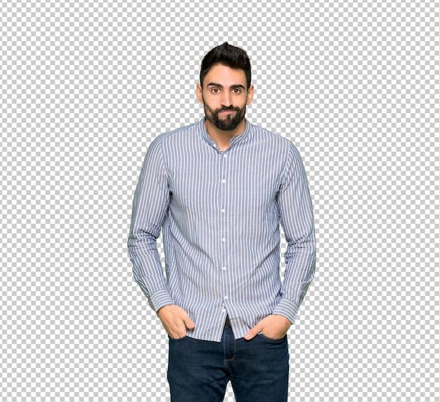 悲しいと落ち込んで表情でシャツを持つエレガントな男