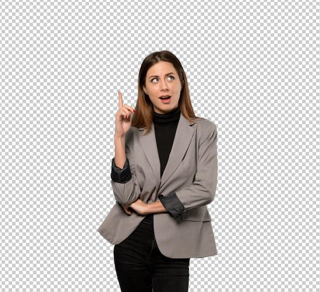 ビジネスの女性の指を上向きにする考えを考えて