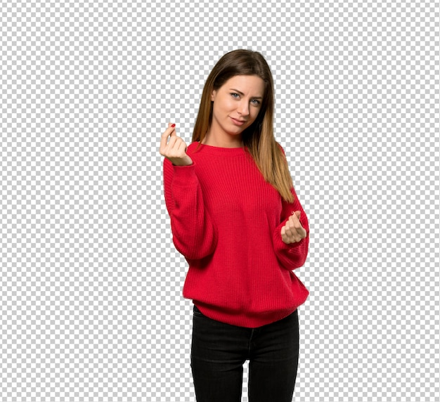 お金のジェスチャーを作る赤いセーターを持つ若い女