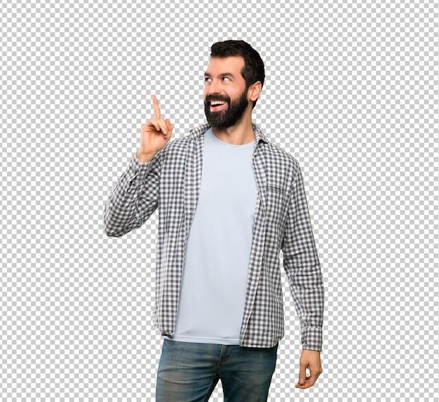 指を持ち上げながら解決策を実現しようとしているひげを持つハンサムな男