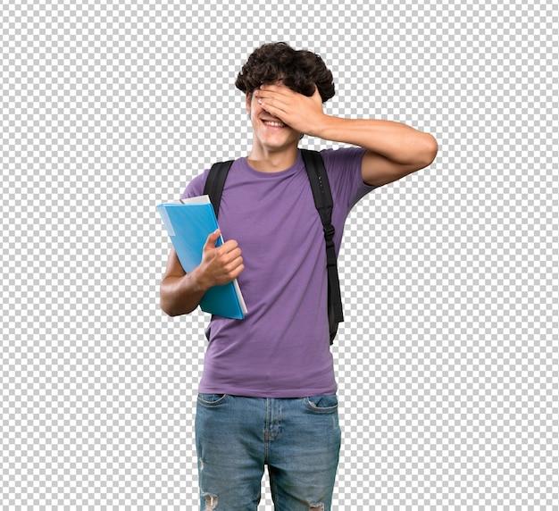 手で目を覆っている若い学生男