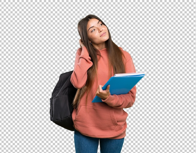 アイデアを考えてノートを保持している若い学生女性