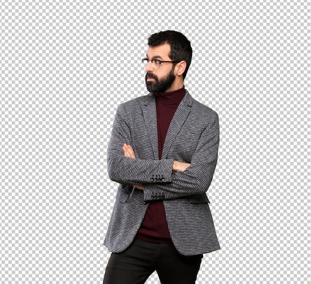 眼鏡の肖像画を持つハンサムな男