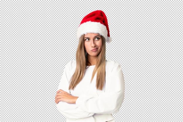 アイデアを考えてクリスマス帽子とブロンドの女の子