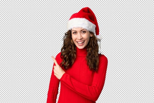 Девушка в шляпе рождество, указывая пальцем в сторону