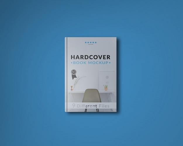 青い背景の本の表紙をモックアップ