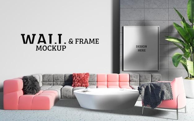 壁とフレームのモックアップ-リビングルームには印象的で柔らかいソファがあります