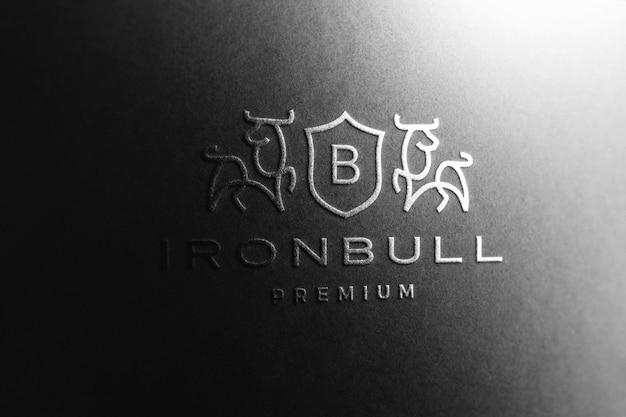 Макет логотипа в черной бумаге