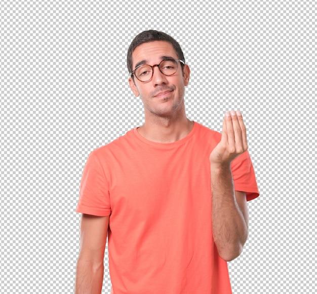 イタリア語のジェスチャーをしている困惑した若い男