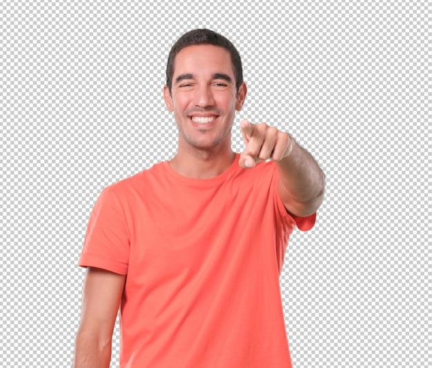Смешные молодой человек, указывая вам рукой