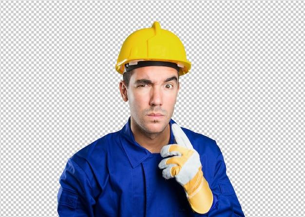白い背景に疑わしい労働者