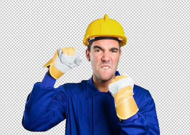 白い背景に怒っている労働者