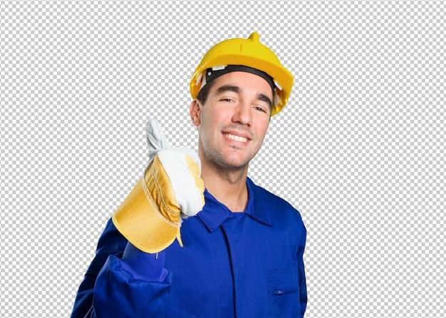 白い背景に大丈夫なジェスチャーを持つ幸せな労働者
